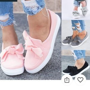 Pink bowed flat loafer style tennis like shoes